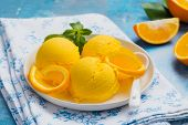 Orange Ice Cream. Summer Orange Sorbet. Homemade Orange Ice Cream With Thyme And Orange Slices poster
