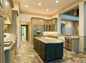 stock photo of armoire  - extravagant kitchen with slate floors and granite counters - JPG