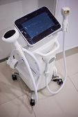 Diode hair removal machine in beauty parlour. poster
