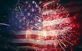 Patriotic holiday. The USA are celebrating 4th of July. American flag on background of fireworks. poster