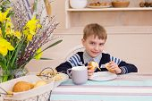 Little Boy Sitting At The Table And Eating Breakfast In The Kitchen. Breakfast Table With Boy. Child poster