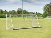 On Football Soccer Field. Behind Goal Of Soccer Field. Soccer Football Net Background Over Green Gra poster