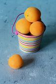 Ripe Apricots In A Decorative Bucket On A Blue Background. Apricots Fruits Delicious Vitamins Ripe Y poster