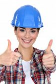Smiling tradeswoman giving two thumb's up