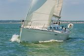 Close up of sailing boat, sail boat or yacht at sea with white sails poster