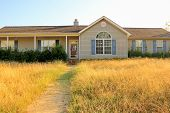 Unkempt Property of Foreclosed Working Class Ranch Style Home