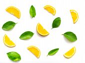 Composition Of Orange Slices Fruits With Green Leaves Isolated On White Background. Top View. Orange poster