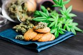 Cannabis Herb, Cookies With Cannabis And Buds Of Marijuana On The Table. A Can Of Cannabis Buds Conc poster