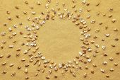 Circle Frame Made Of Tiny Sea Shells On Beach Sand Background. Mini Small Shells On Sand With Empty  poster