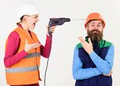 Builder Makes Hole In Male Head. Husband Annoyed By Wife. Carefree And Relaxed Concept. Woman Drills poster