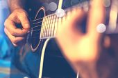 Acoustic Guitar And Guitarist Detail.live Music And Musical Instrument poster