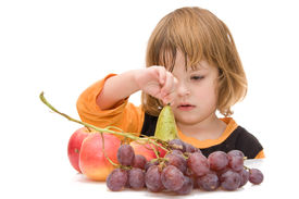 picture of healthy eating girl  - little girl and fruits isolated on white - JPG