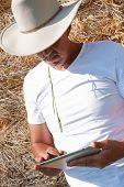 Farmboy using tablet