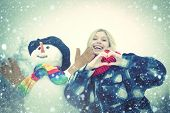 Happy Smiling Girl Make Snowman On Sunny Winter Day. Winter Emotion. Outdoor Portrait Of Girl In Col poster