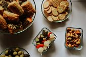 Selection Of Salty Food, Cookies, Pickles, Olives poster