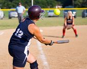 stock photo of softball  - Popped up ball during a girls softball game - JPG