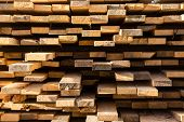 Stacked Lumber Background. Folded Wood. Close-up Cross Section Of Board. Boards Stick Out From Pile  poster