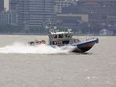HOBOKEN, NJ - MAY 23: A NYPD boat patrols the Hudson River between Manhattan New Jersey during the P