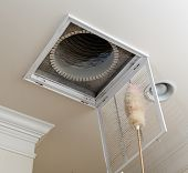 stock photo of hvac  - Dusting the vent for air conditioning filter in ceiling of modern home - JPG