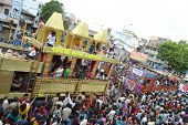 Decorated Trucks Driving By During Rathyatra Journey