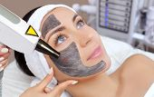 Cosmetologist Does Carbon Face Peeling Procedure Of A Beautiful, Young Woman In A Beauty Salon. Hard poster
