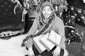 Man Smile With Present Boxes At Christmas Tree. Macho With Tinsel In Hat, Sweater Prepare For Party. poster