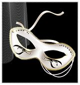 image of mummer  - on an black background is a carnival white half mask decorated with beads and ribbon - JPG