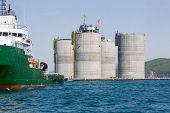 Ocean tug towing base offshore oil drilling platform. Sea of Japan. Russian coast.