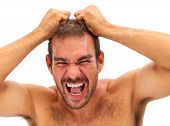 Man Pulling His Hair And Yelling On White Background