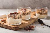 Parfait. Granola Parfait. Delicious Natural Yogurt Parfait With Caramel, Pecan Nuts On Conctere Back poster