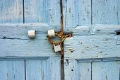 Old Blue Door Detail With Chain And Padlock