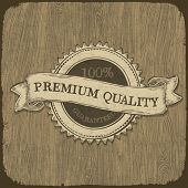 Vintage label with premium quality text on wooden texture.  Vector, EPS10.