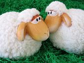 Two Little Toy Sheeps On Green Grass Background