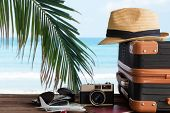 Summer Travel And Plan With Vintage Suitcase Luggage And Old Camera In The Sand Beach. Travel In The poster
