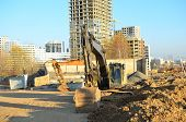 Excavator Loads Of Stone And Rubble For Processing Into Cement Or Concrete For Construction Work. Cr poster