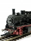 pic of smut  - A model of a steam engine on white background - JPG