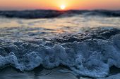 Closeup Waves Of The Mediterranean Sea With Sea Foam And Spray. Beautiful Sea On Sunset Background.  poster