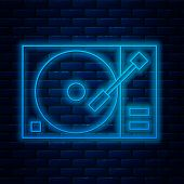 Glowing Neon Line Vinyl Player With A Vinyl Disk Icon Isolated On Brick Wall Background. Vector Illu poster