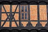 Half-timber wall and window of old medieval house in the historical center of Goslar, Germany.       poster
