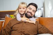 Adorable Little Girl Hugging Father From Behind poster