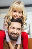 Adorable Little Girl Sitting On Shoulders Of Her Dad poster