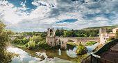 Besalu, Girona, Catalonia, Spain. Famous Landmark Old Medieval Romanesque Besalu Bridge Over The Flu poster
