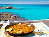 Paella mediterranean rice food by the Balearic Formentera island beach [ photo-illustration]