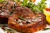 stock photo of pork cutlet  - Grilled steaks and vegetable salad - JPG