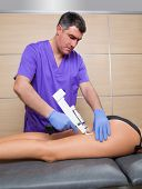 mesotherapy gun therapy for cellulite doctor with woman leg thigh