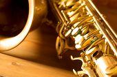 Sax golden tenor saxophone in vintage retro background