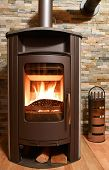 picture of cozy hearth  - Wood burning stove in front of stonwall - JPG