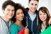 stock photo of classmates  - Portrait of happy students together at college - JPG
