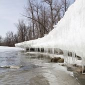 Spring thaw producing icicles along river