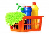 Plastic orange basket with cleaning supplies, isolated on white background